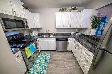Stainless Steel Appliances | Kitchens featuring stainless steel appliances in select apartments.