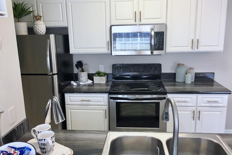 Kitchen | Newly renovated kitchens with stainless steel appliances in select apartments.