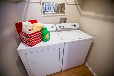 Laundry Room | Laundry rooms featuring full size washer and dryer appliances.