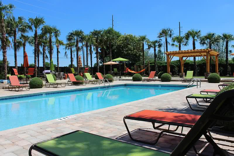 Pool with Expansive Sundeck | Go for a swim at our pool or lay out on the sundeck.