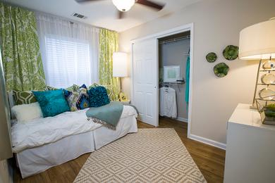 Bedroom | Spacious bedrooms with a ceiling fan and closets with built-in organizers.