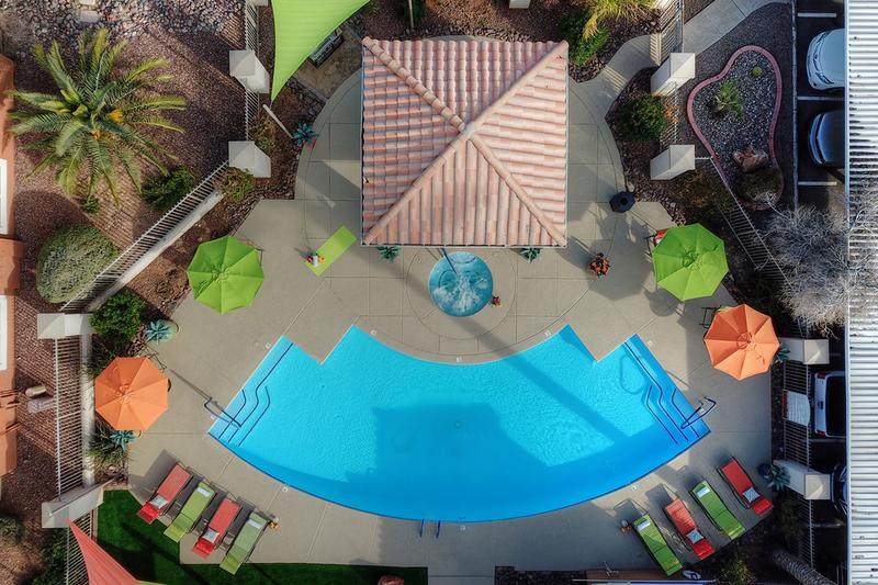 Aerial View of Pool | Stretch out on our vibrant pool loungers or have a picnic under the shade of our umbrellas from the Arizona rays!
