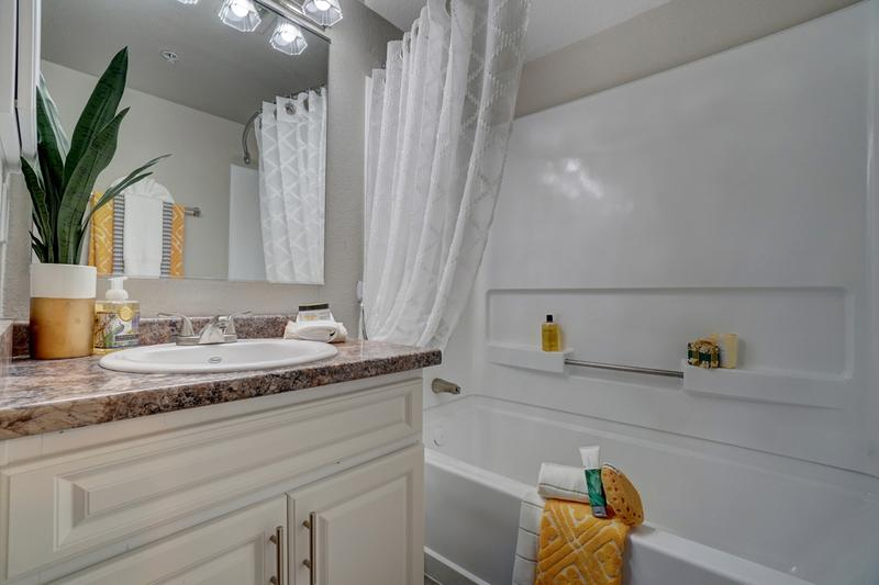 Bathroom | Our bathrooms come with gorgeous granite-style countertops and plenty of storage with cabinetry below and a medicine cabinet too!