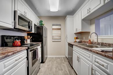Galley Style Kitchens | If you love to cook, then our galley-style kitchen is perfect for you, equipped with stainless steel appliances and plenty of counter space!