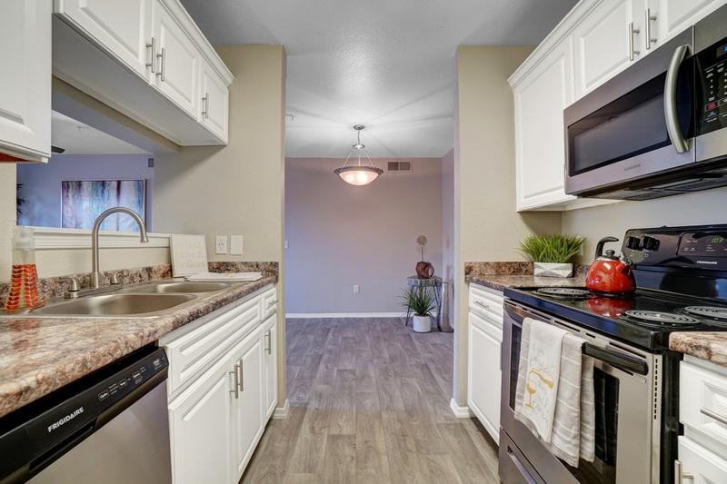 Stainless Steel Appliances | The kitchen offers plenty of cabinet space as well and opens up into the dining and living room; perfect for entertaining!