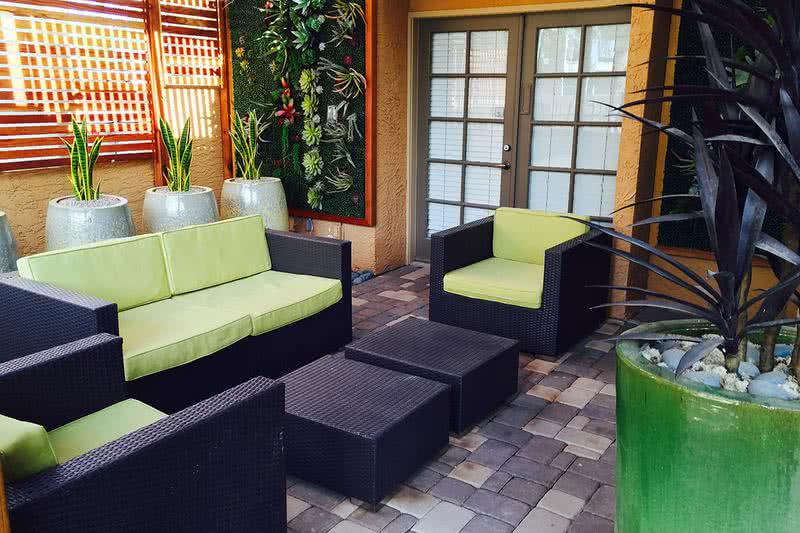 Outdoor Lounge | Catch up on some reading at the clubhouse patio.