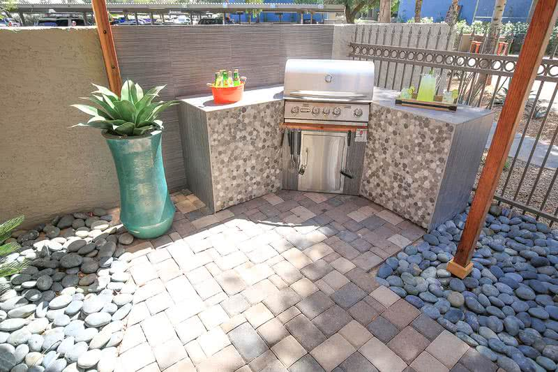Outdoor Kitchen | Have a cook out at our outdoor kitchen featuring a gas grill.