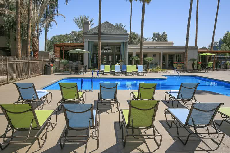 Expansive Sundeck | Soak in the sun and relax on our expansive sundeck, complete with poolside loungers and tables with umbrellas.