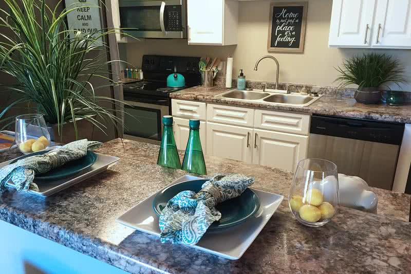 Updated Kitchens with Breakfast Bar | Updated kitchens feature granite-style countertops, stainless steel appliances and a breakfast bar.