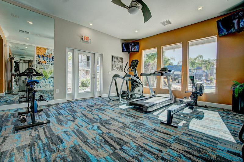 Fitness Center | Our newly renovated fitness center features gorgeous views of the pool, state-of-the-art equipment, televisions, and free weights!