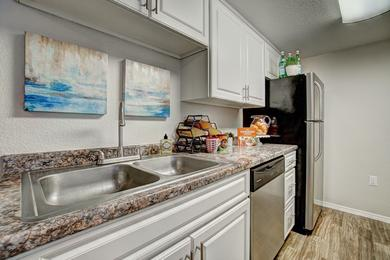 Stainless Steel Appliances | Kitchens feature stainless steel appliances, including a dishwasher!