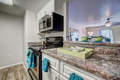 Granite-Style Countertops | Enjoy the fresh look of granite-style counter tops and white cabinetry.