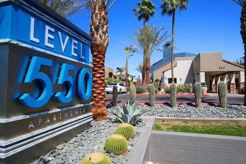 Welcome to Level 550 | You will be welcomed home with lush landscaping around the community.