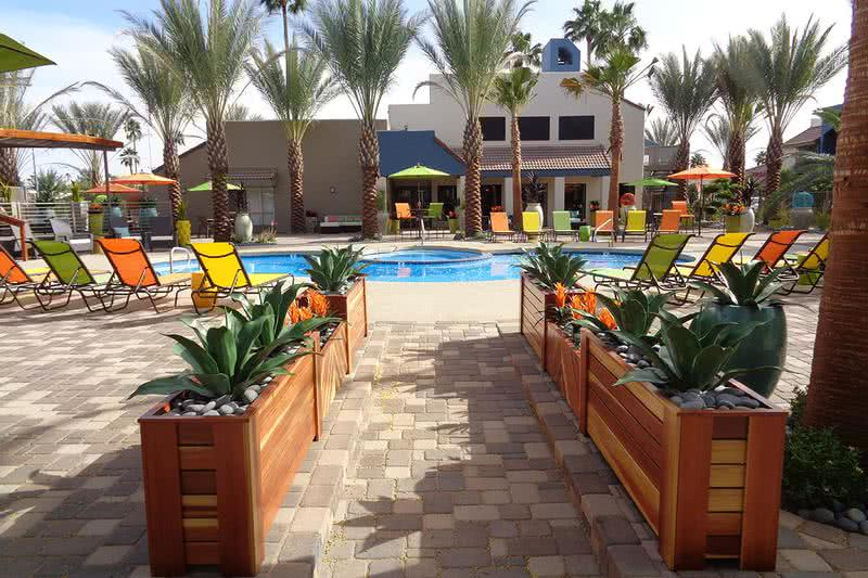 Pool Area | Spacious pool area with plenty of poolside seating and tables.