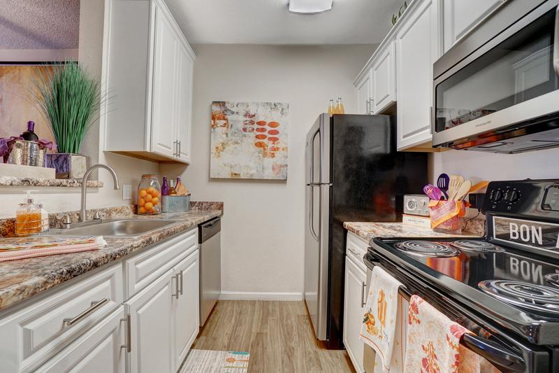 Renovated Kitchen | Your newly renovated kitchen is complete with a dishwasher and breakfast bar.