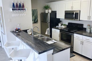 Renovated Kitchen | Take advantage of our premium renovation package and enjoy black fusion counter tops in your kitchen.