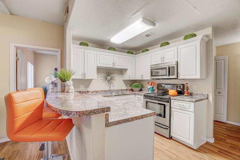 Chef Inspired Kitchen | Large, open kitchen with new stainless steel appliances and ample amounts of storage space.