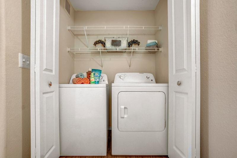 Washer & Dryer Included | Separate laundry area with shelving.