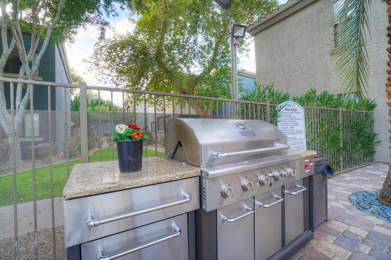 Outdoor Kitchen | Cookout by the pool utilizing our gas grill.