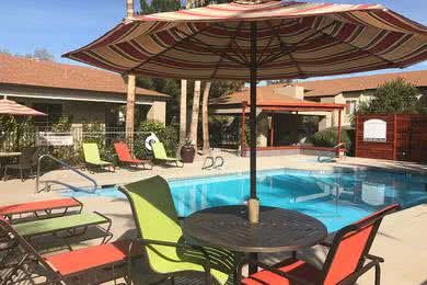 Poolside Loungers & Tables | Lay out by the pool in one of the loungers or at our tables with umbrellas.