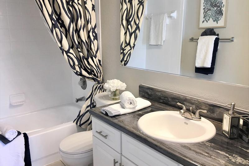 Renovated Bathroom | Upgrade to our premium renovation package and enjoy black fusion counter tops in your bathroom as well!