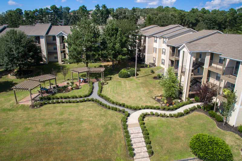 Aerial View of Courtyard | Our courtyard is a great place to sit outside and relax. Enjoy our lush landscaping surrounding the community.