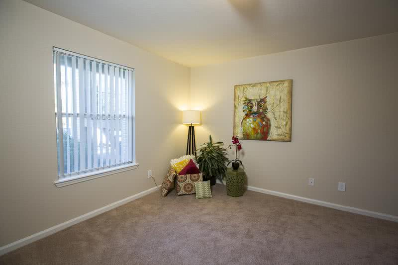 Bedroom | Spacious bedrooms featuring plush, neutral carpeting and ceiling fans.