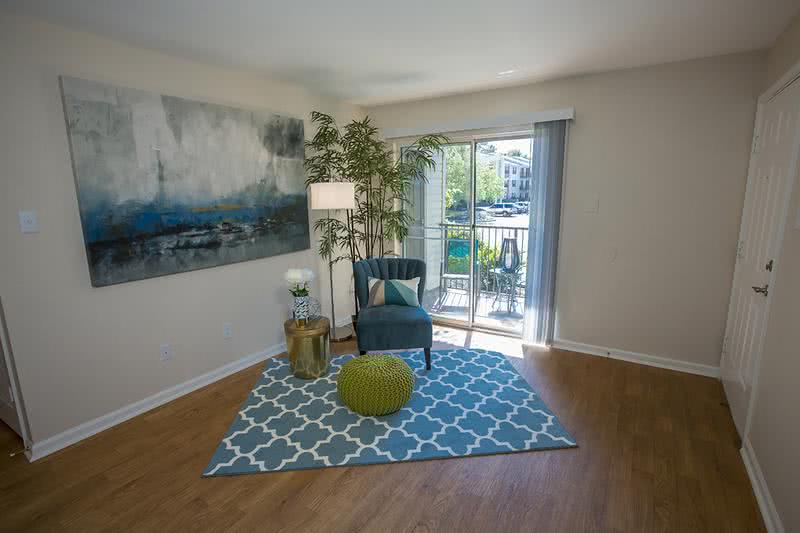 Living Room | Your spacious living room features wood-style flooring and sliding doors to your private patio/balcony.