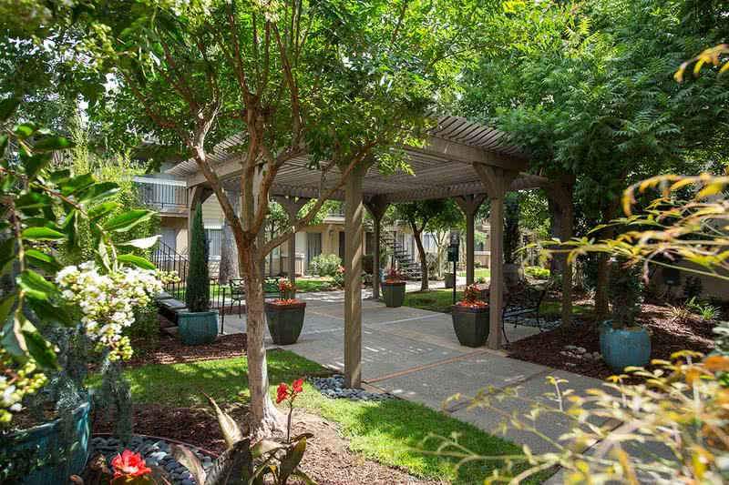 Pavilion | Beautifully landscaped grounds with community seating areas.