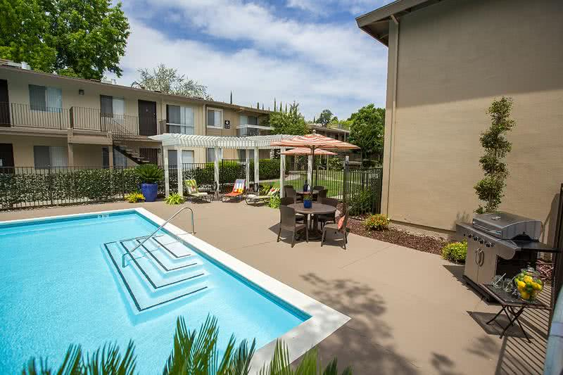 BBQ Grill | Residents have the luxury of using our poolside grill. Have a cookout with friends and family while sitting under one of our tables with umbrellas.