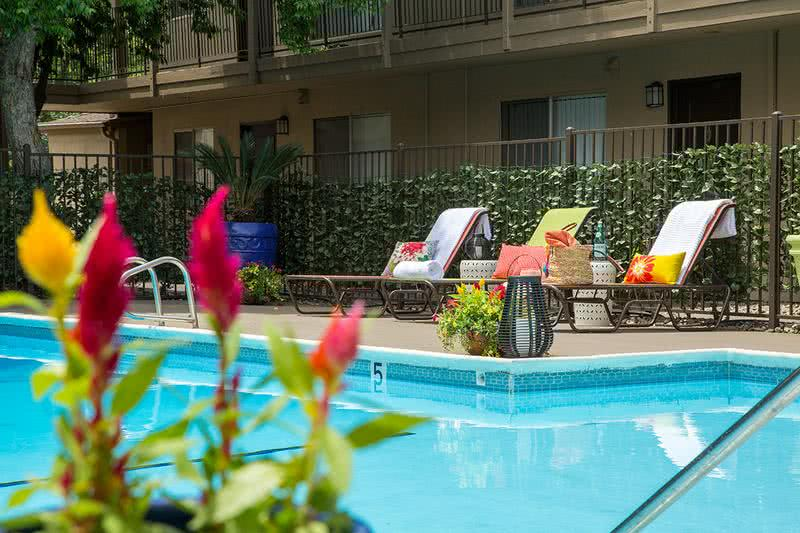 Resort-Style Swimming Pool | Soak in the sun on our expansive sundeck and take a dip in our resort-style swimming pool to escape the hot California weather!