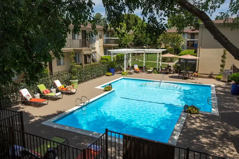 Resort-Style Pool | Newly renovated pool area with resort style furniture and a newly built trellis area with seating.