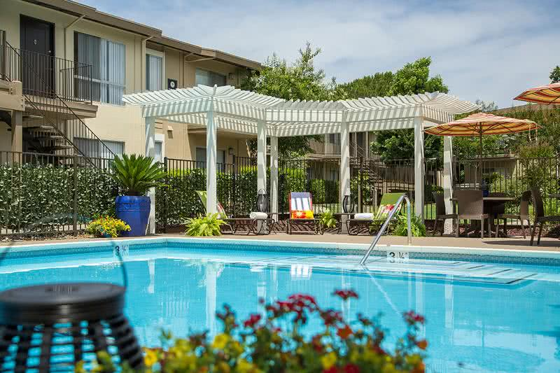Poolside Trellis | Relax under our trellis next to the pool.