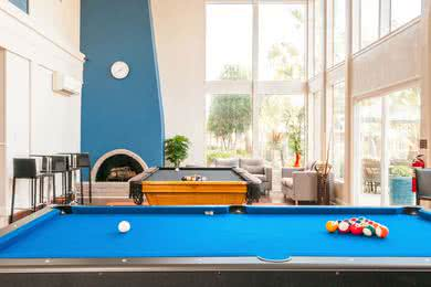 Billiards | Our resident game room features 2 billiards tables and a fireplace.