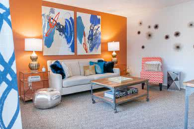 Living Room | Spacious living rooms with plush, neutral carpeting.