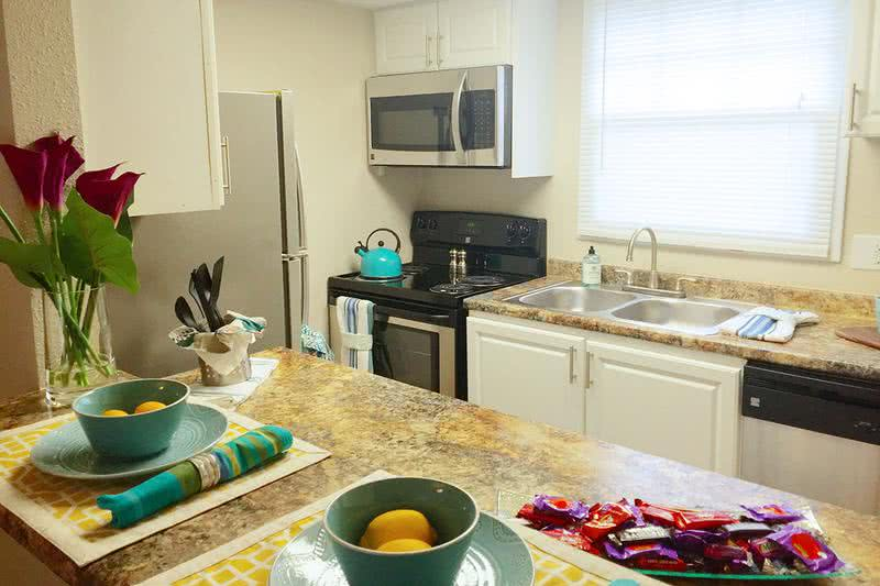 Townhome Kitchen | Your new kitchen is fully stocked with stainless steel appliances, including a dishwasher!