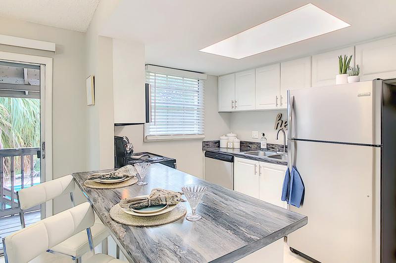 Renovated Black Fusion Kitchen | Newly renovated kitchens with updated white cabinetry and black fusion countertops.  We are excited to offer in-person tours while following social distancing and we encourage all visitors to wear a face covering.