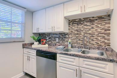 Granite Style Countertops | Kitchens featuring white cabinetry and granite-style countertops.