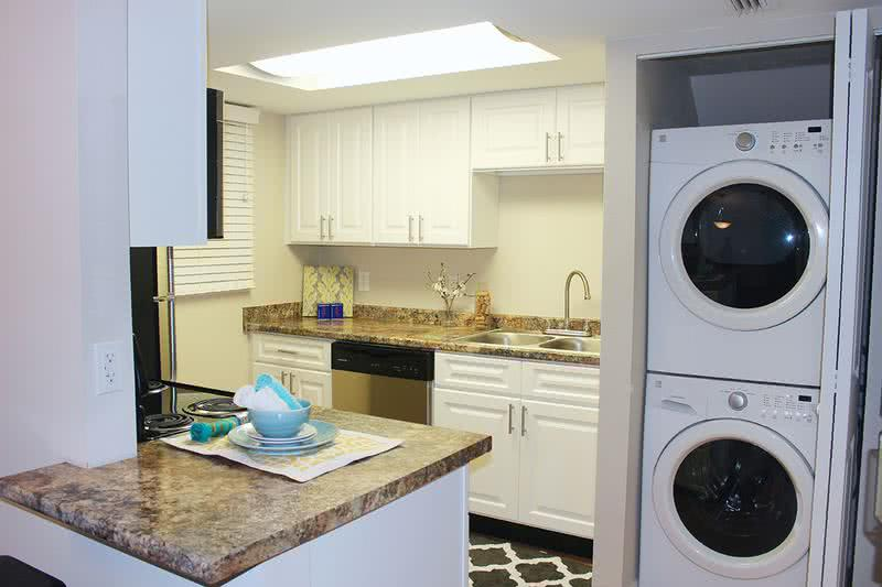 The Poplar Kitchen | Your newly remodeled kitchen is complete with washer and dryer connections in the closet.