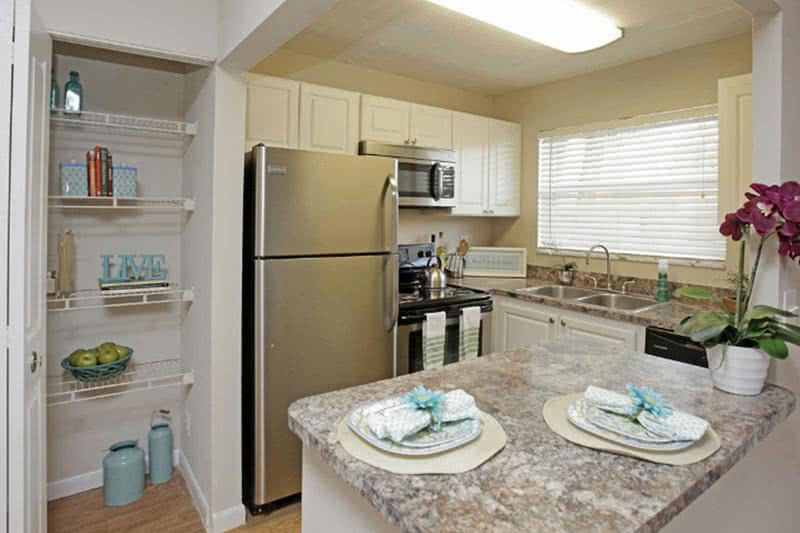 Newly Remodeled Kitchens | Our apartment homes feature newly remodeled kitchens featuring granite-style countertops, stainless steel appliances, and a pantry.