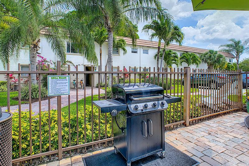 Gas Grills | Utilize our gas grills by the pool to have a cookout with friends and family.
