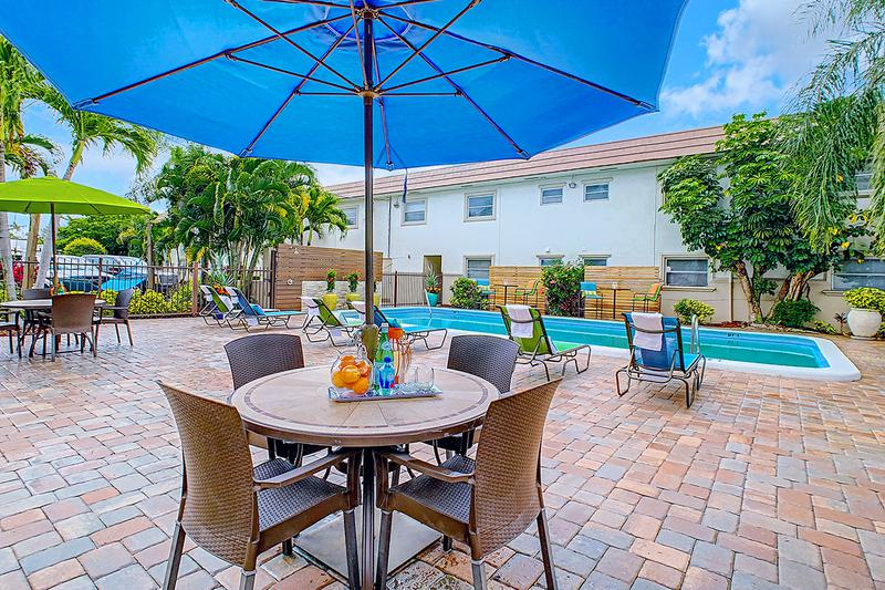 Expansive Sundeck | Lay out on one of our poolside loungers, or relax at one of our tables with umbrellas on our expansive sundeck.