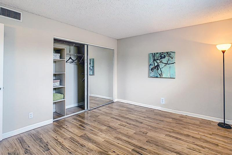 Bedroom | Spacious bedrooms featuring wood-style flooring, and large closets with built-in organizers.