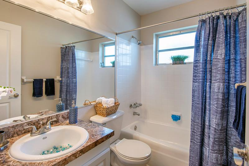 Bathroom | Bathrooms featuring updated countertops and cabinets and large mirrors.