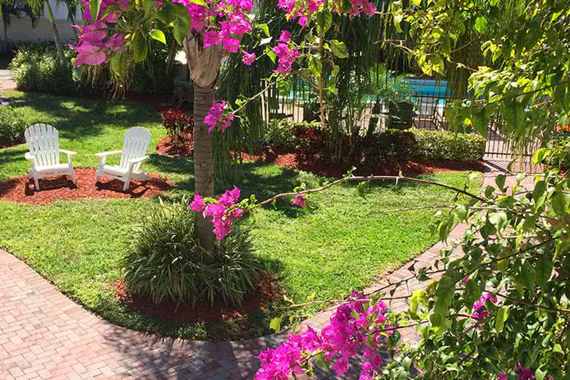 Courtyard | A nice location to sit and relax and enjoy your south Florida surroundings and our beautiful lush landscaping.