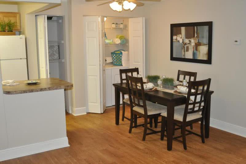 Dining Room | Dining room with ceiling fans and laundry area.