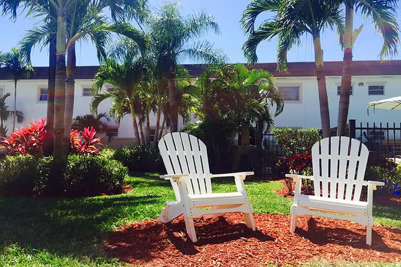 Seating Area | Enjoy our courtyard area; complete with Adirondack chairs ideal for putting your feet up after a long day!