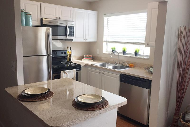 Kitchen | Kitchens are fully applianced including a dishwasher and breakfast bar!