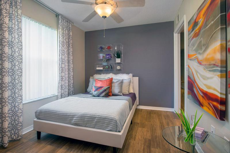 Guest Bedroom | Bedrooms feature ceiling fans and wood-style flooring.