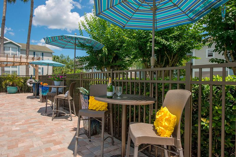 Poolside Tables | Our sundeck features plenty of tables with umbrellas.